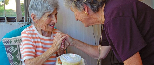In-home care and meals on wheels continue to help vulnerable Nazi victims during Argentina's ongoing financial crisis.